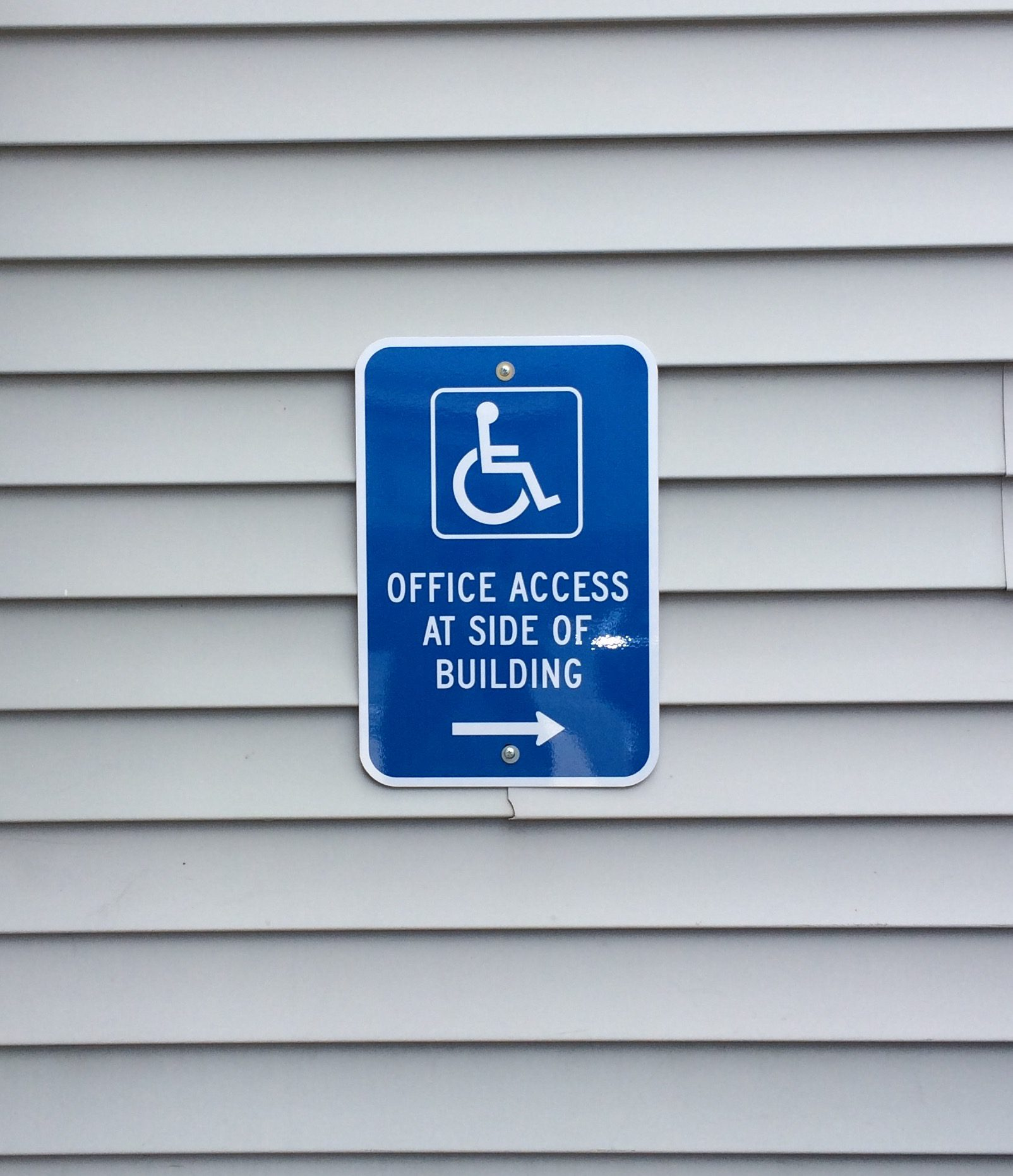 Directornal Signage to accessible netrance.