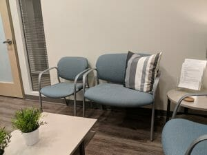 gray blue oversized chair in doctor's office