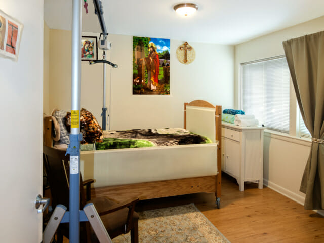 view into Abbi's bedroom with lift in left side and twin bed.