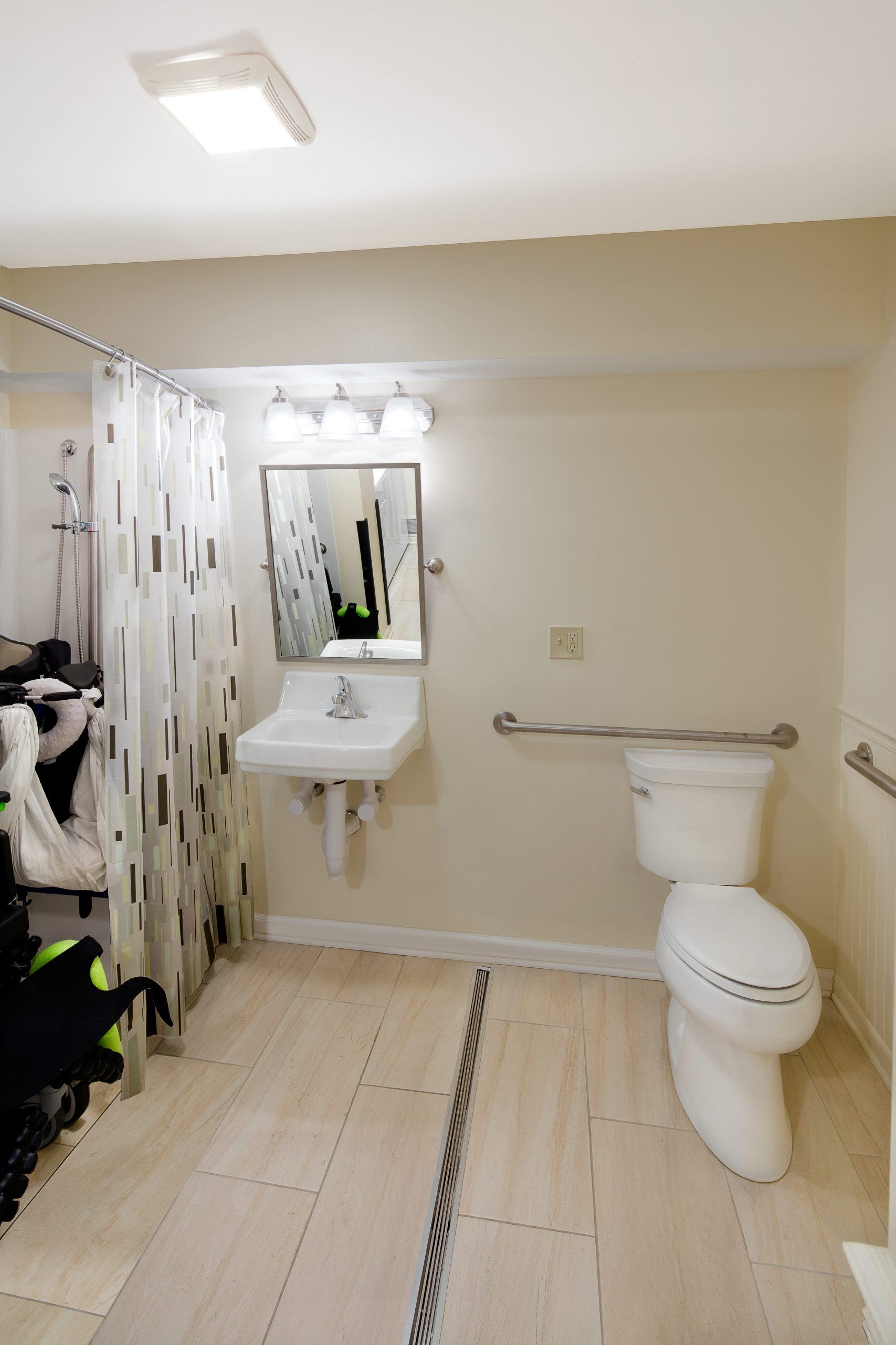 renovated bathroom with roll-in shower on the left